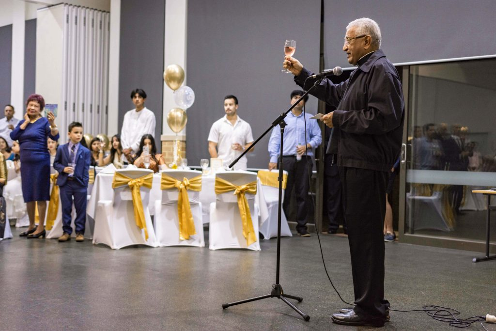 Mrs Carvalho's godson Fr Gino Henriques CSsR raises his glass to toast the 100-year-old lady. Photo: Eric Martin.