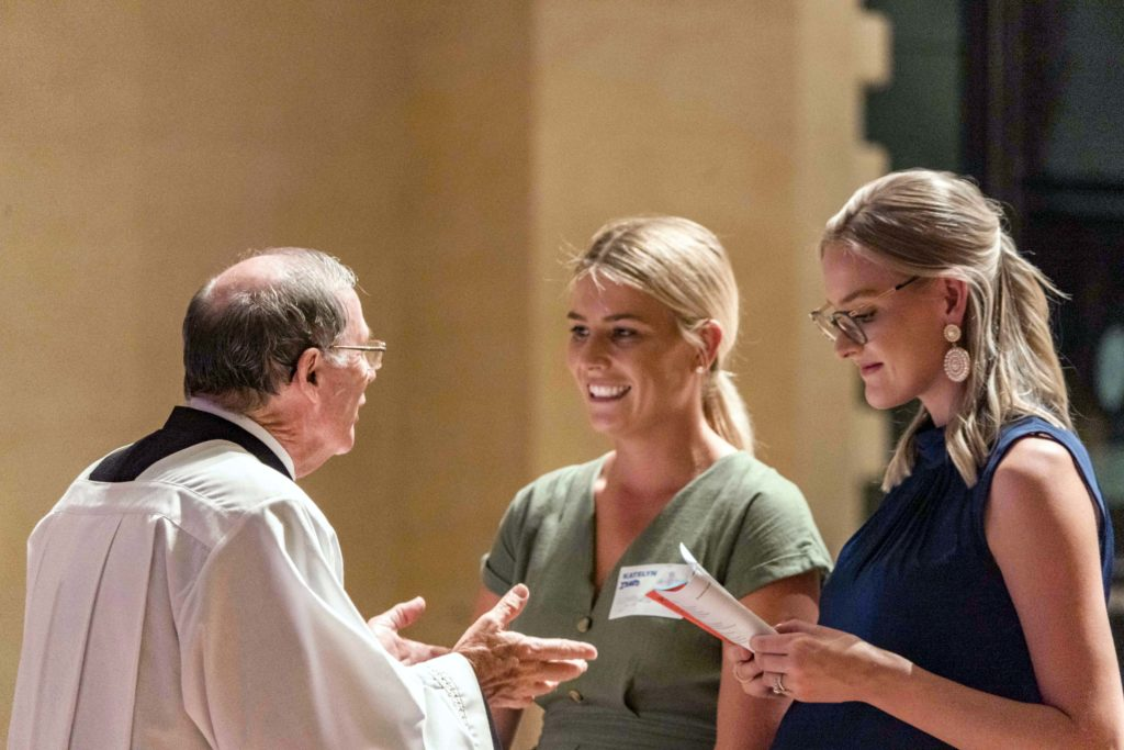 Fr Peter Whitely speaking to one of the catechumens during the Rite of Election of Catechumens and Formal Recognition of Candidates held at the St Marys Cathedral on 14 March. Photo: Josh Low.