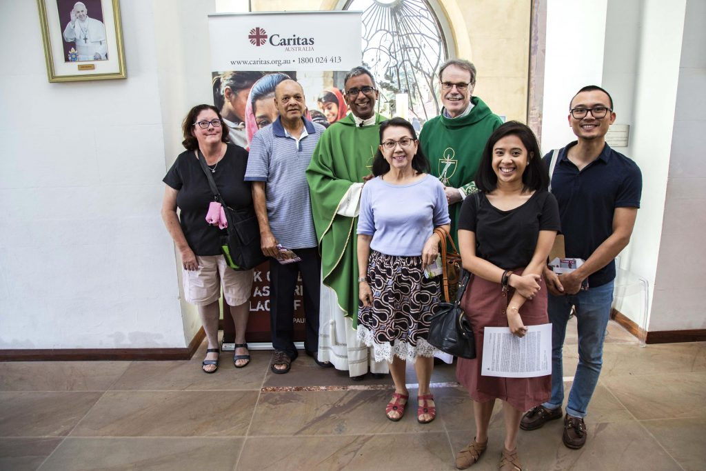 St Mary's Cathedral parishioners pose with Cathedral Dean Fr Sean Fernandez and Caristas Australia Perth Director, Deacon Paul Reid, on the parishes launch of Project Compassion for 2019, Sunday 3 March. Photo: Jamie O'Brien.