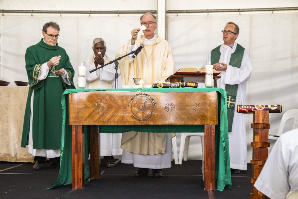 Deacon Paul Reid, Fr Sebastian Fernando, Bishop Don Sproxton and Fr George Kolodziej during the consecration for the Mass marking the start of Project Compassion for 2019. Photo: Eric Martin.