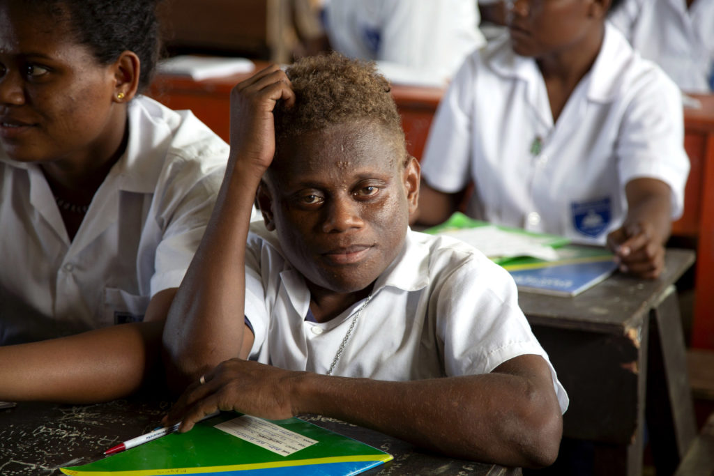 Peter in class at Aligegeo Secondary School. Photo: Caritas Australia/ Cassandra Hill.