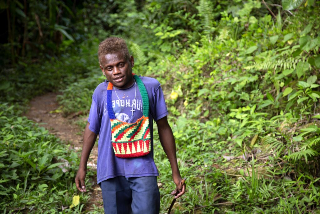 Peter on his long daily walk to find water to drink and bathe in Malaita, Solomon Islands. Photo Cassandra Hill/Caritas Australia.