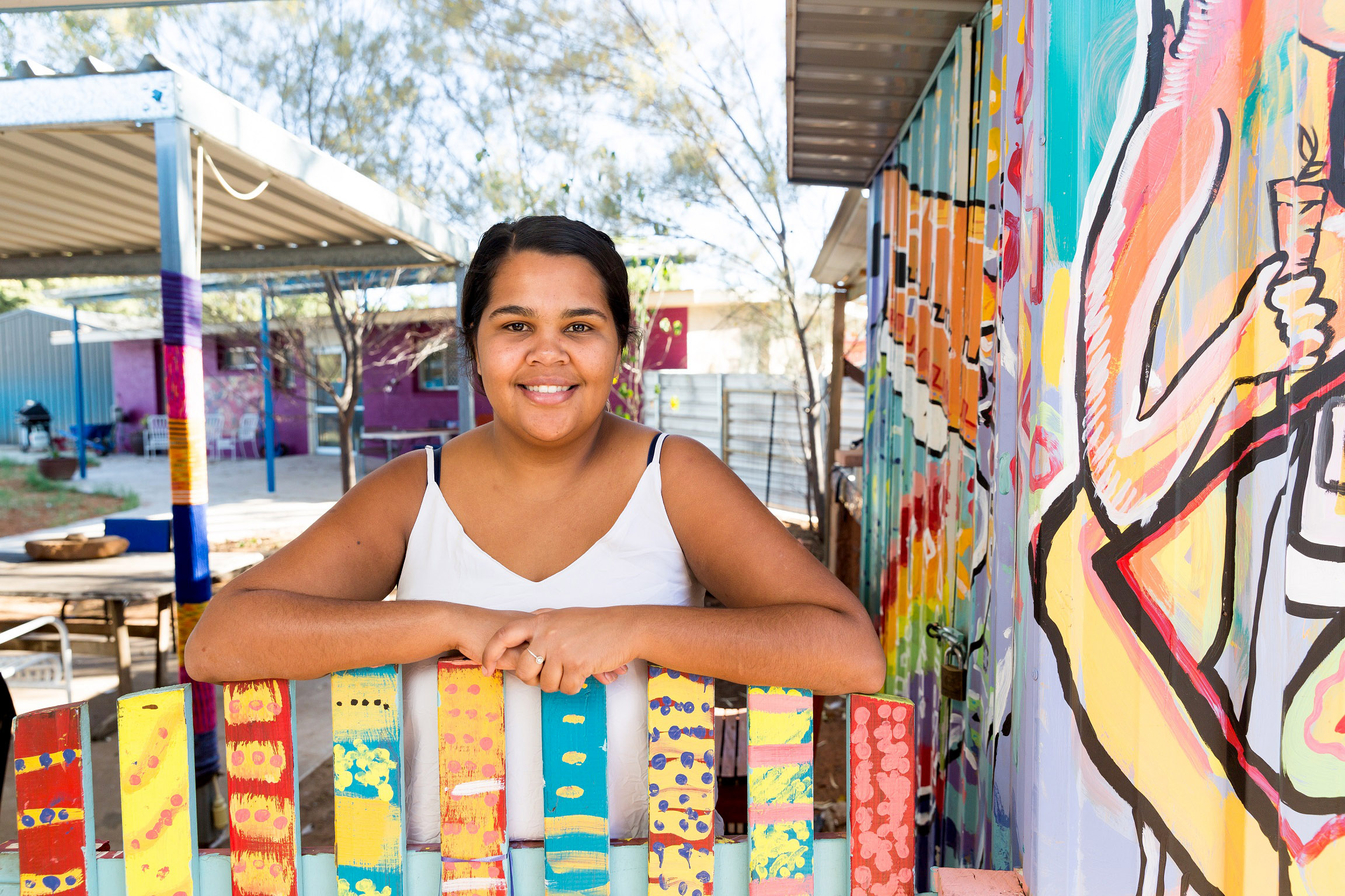 Michaela stands outside the Purple House where she is a trainee. Photo: Emma Murray/ Caritas Australia.