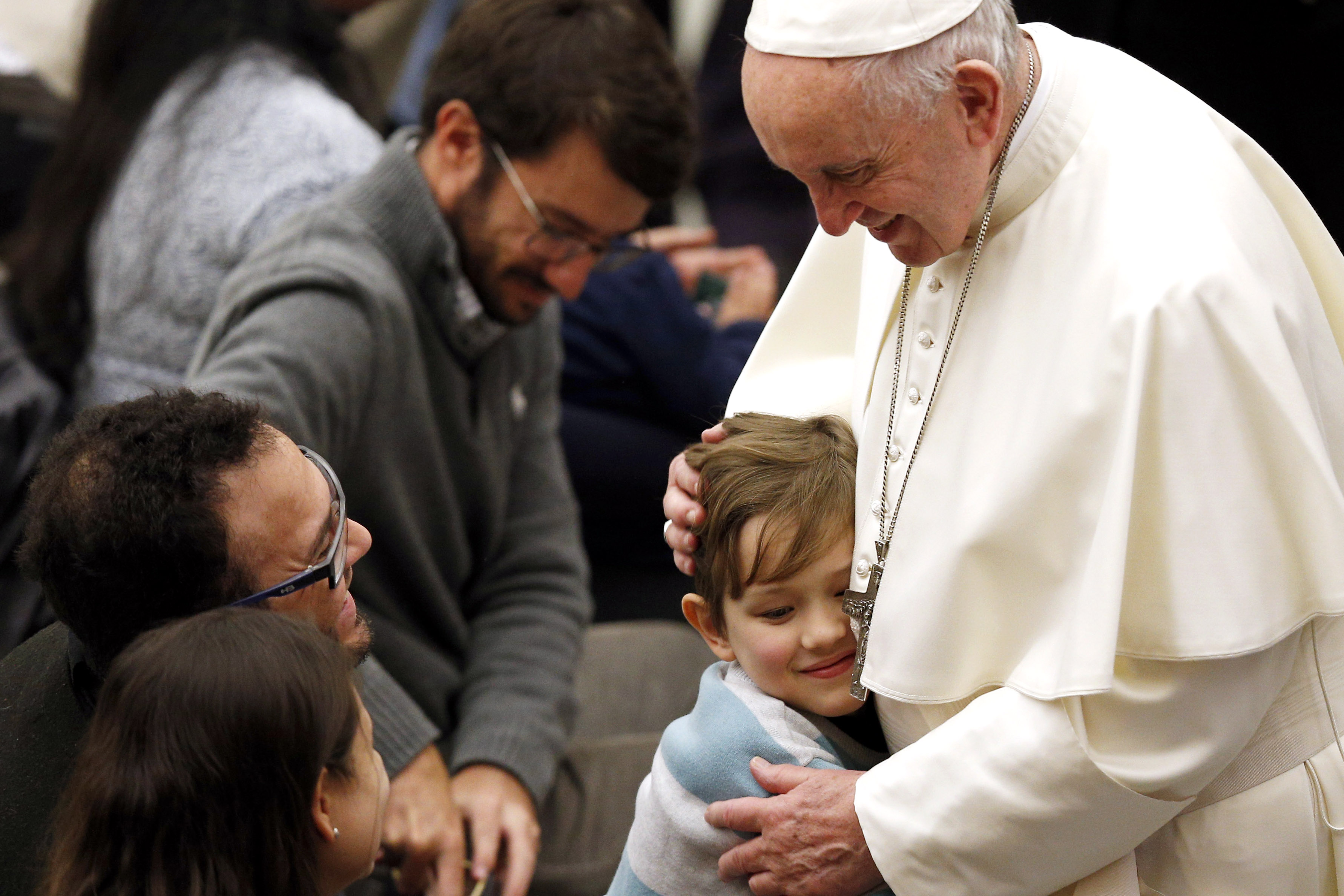 A boy embraces Pope Francis during his general audience in Paul VI hall at the Vatican ON 9 January 2019. Photo: CNS/Paul Haring.