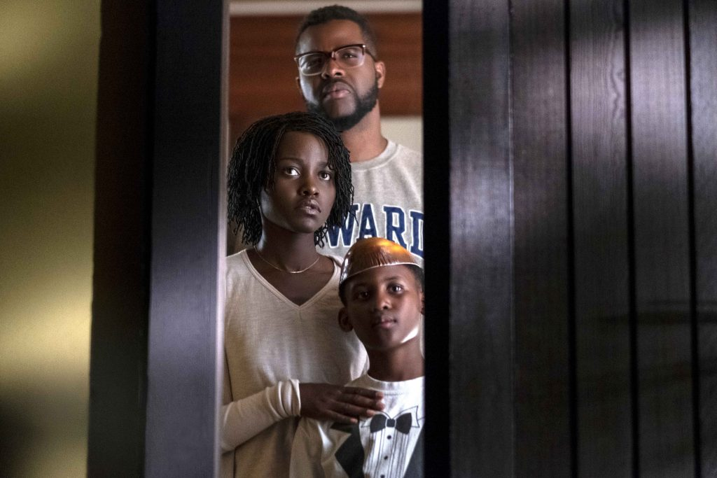 "Winston Duke, back, Lupita Nyong'o and Evan Alex star in a scene from the movie ""Us"". Photo: Universal/CNS."