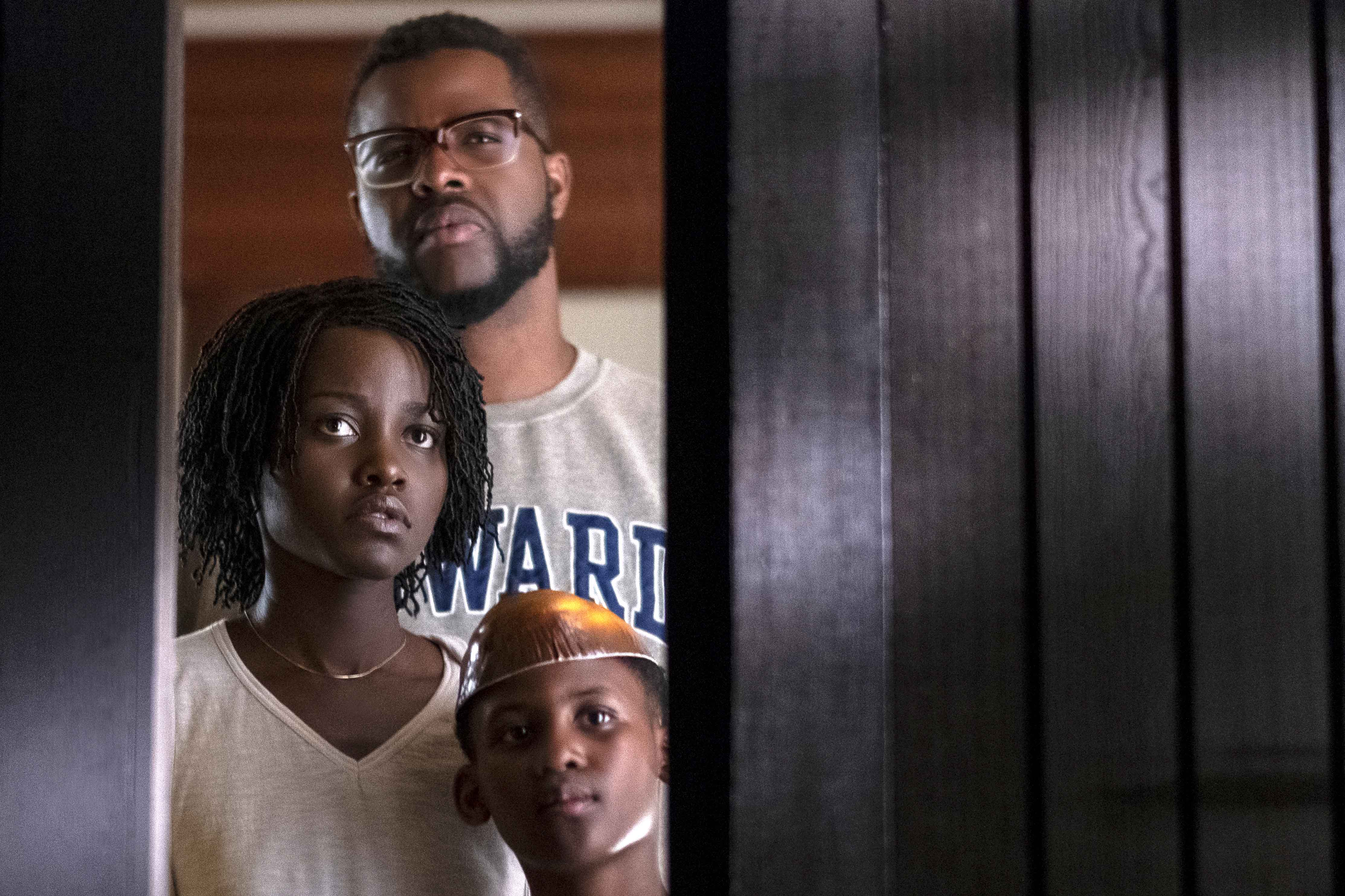 Winston Duke, back, Lupita Nyong'o and Evan Alex star in a scene from the movie