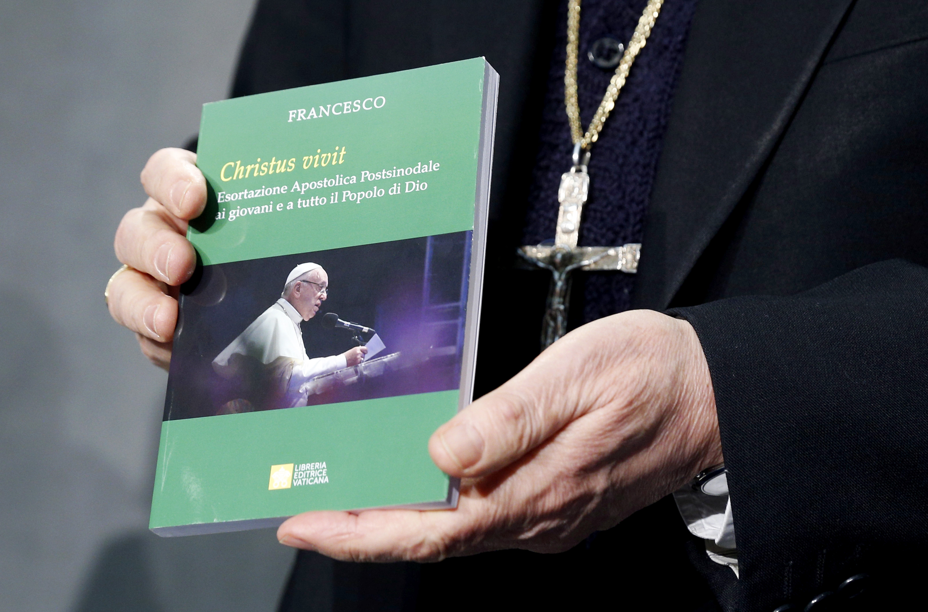 "Cardinal Lorenzo Baldisseri, Secretary-General of the Synod of Bishops, holds Pope Francis' Apostolic Exhortation, ""Christus Vivit"