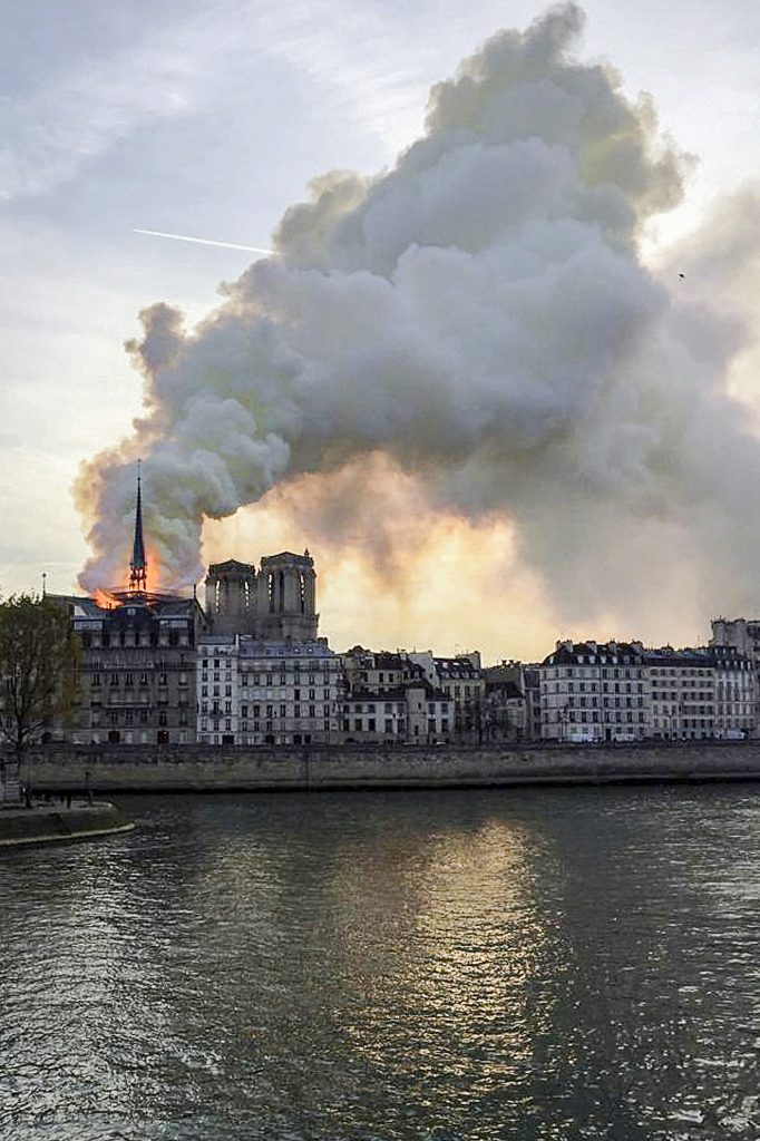 Flames and smoke billow from the Notre Dame Cathedral after a fire broke out in Paris on 15 April 2019. Officials said the cause was not clear, but that the fire could be linked to renovation work. Photo: Julie Carriat/Reuters.