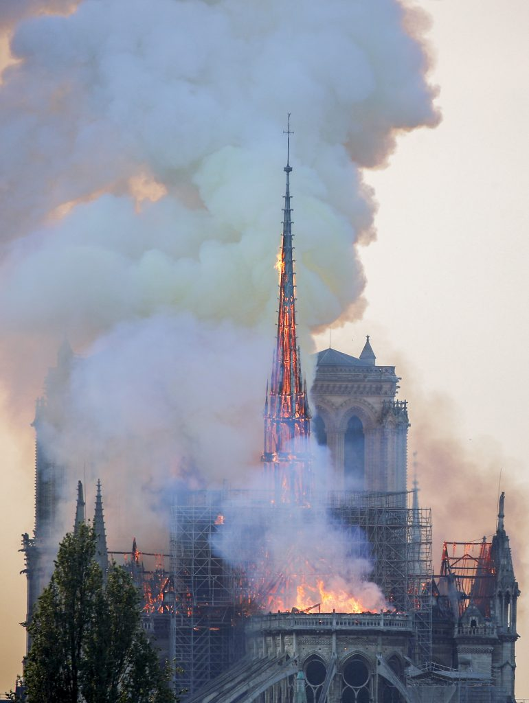 Flames and smoke billow from the Notre Dame Cathedral after a fire broke out in Paris on 15 April 2019. Officials said the cause was not clear, but that the fire could be linked to renovation work. Photo: Charles Platiau/Reuters.