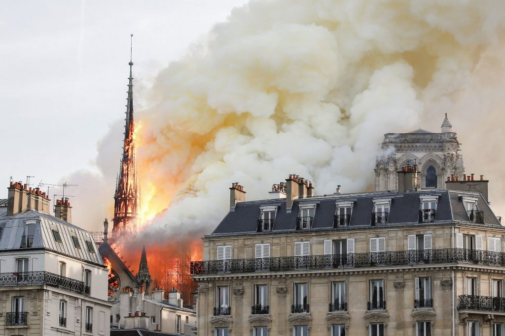 Flames and smoke billow from the Notre Dame Cathedral after a fire broke out in Paris on 15 April 2019. Officials said the cause was not clear, but that the fire could be linked to renovation work. Photo: Benoit Tessier/Reuters.