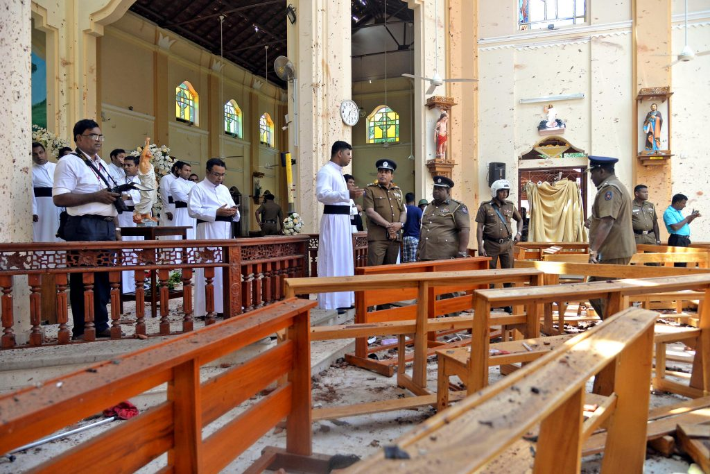 Police officials look over the scene after a bombing where at least 200 people were killed and hundreds more injured on Easter Sunday in Sri Lanka when attackers unleashed an apparently coordinated series of bombings that simultaneously targeted Christian churches and luxury hotels. Photo: Reuters/CNS.