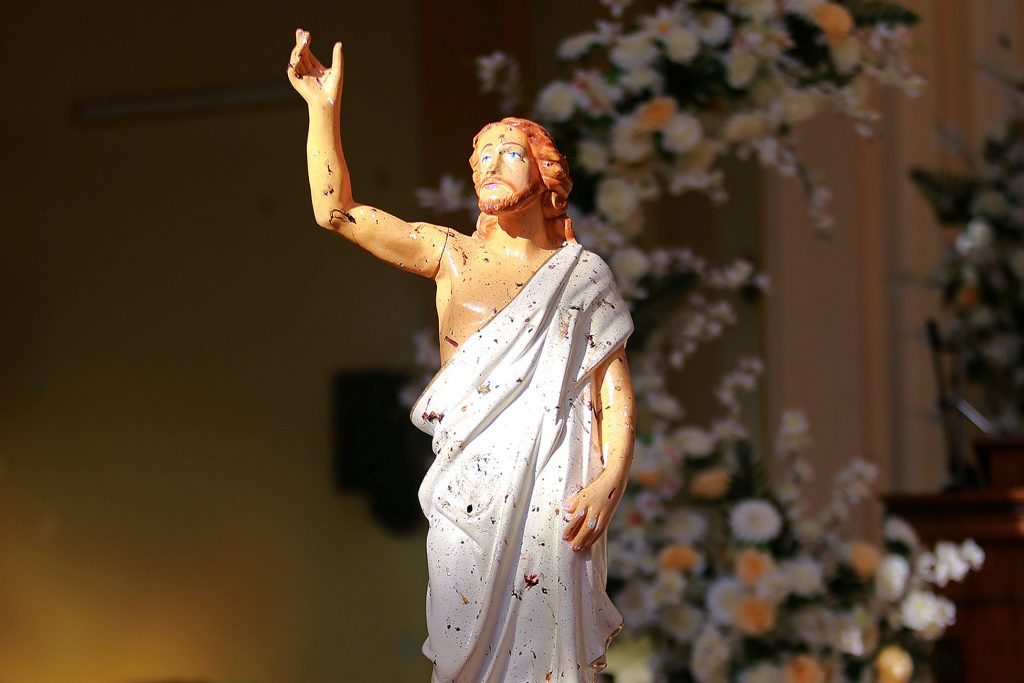 A blood-stained statue of Christ is seen after a bombing at St Sebastian Church in Negombo, Sri Lanka on 21 April 2019. Photo: Reuters/CNS.