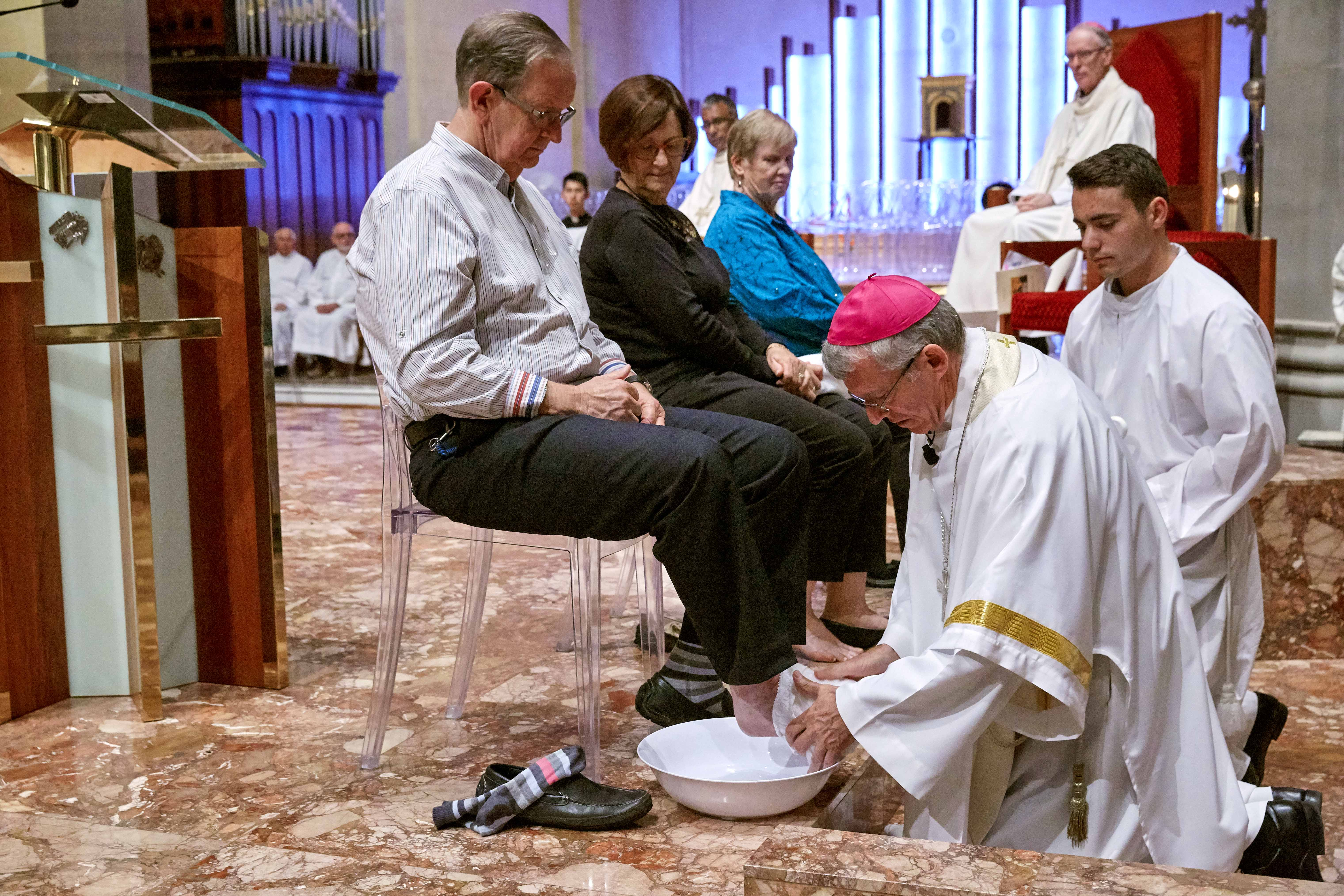 Archbishop Costelloe washes the feet of Cathedral Supervisor Tony Meyrick during the Mass for Holy Thursday at St Mary's Cathedral on Thursday 19 April. Photo: Ron Tan.