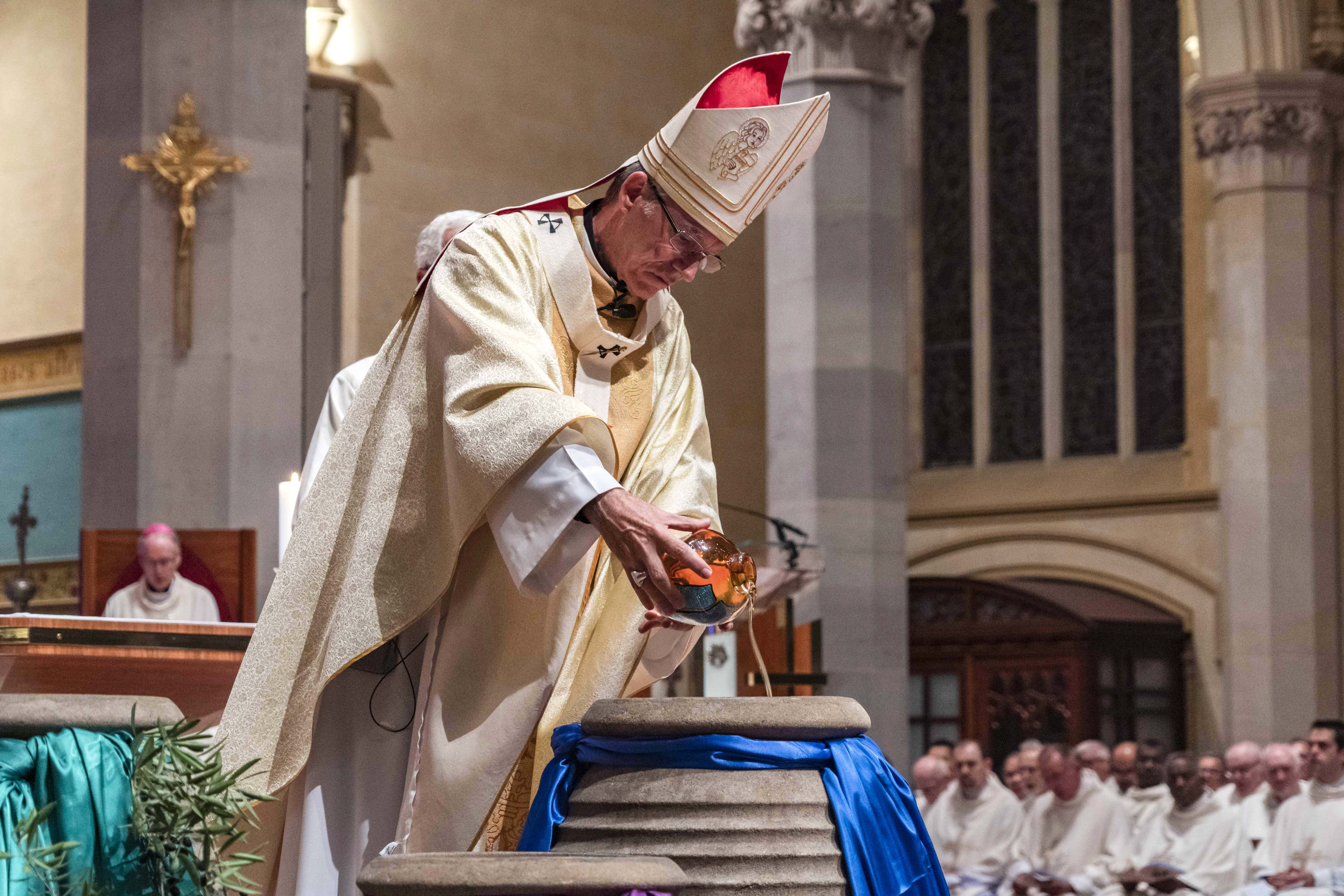 Archbishop Costelloe blessed the Holy Oils, all of which will be used for Sacraments of Confirmation, Ordination, Anointing of the Stick and Baptism in the coming year. Photo: Matthew Lau.