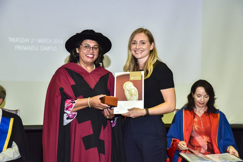 Head of Fremantle Campus Professor Selma Alliex presents the University Medal to Alexandra Brindley. Photo: Supplied.