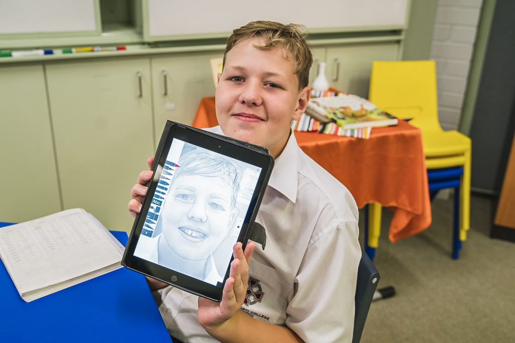 Corpus Christi Year 7 and 8 Education Support students have the opportunity to teach older students with disability and college staff as part of the Digital Creativity course. Photo: Clare Pickersgill.