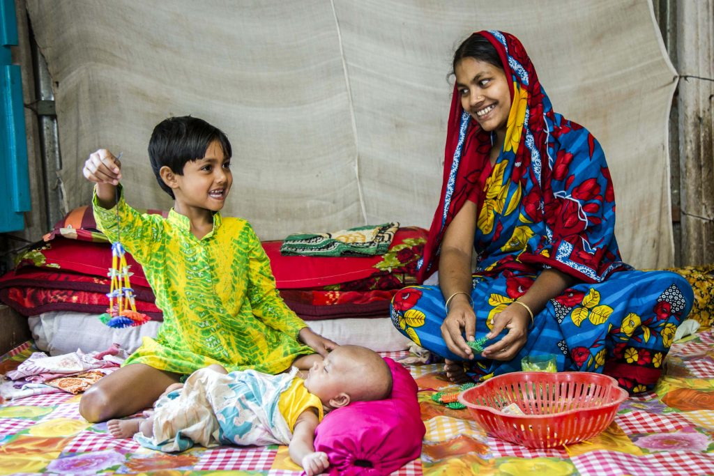 Salma spends quality time with her newborn baby boy Samiul and her daughter Maya. They tell stories and play games. Photo: Ashish Peter Gomes/Caritas Australia.
