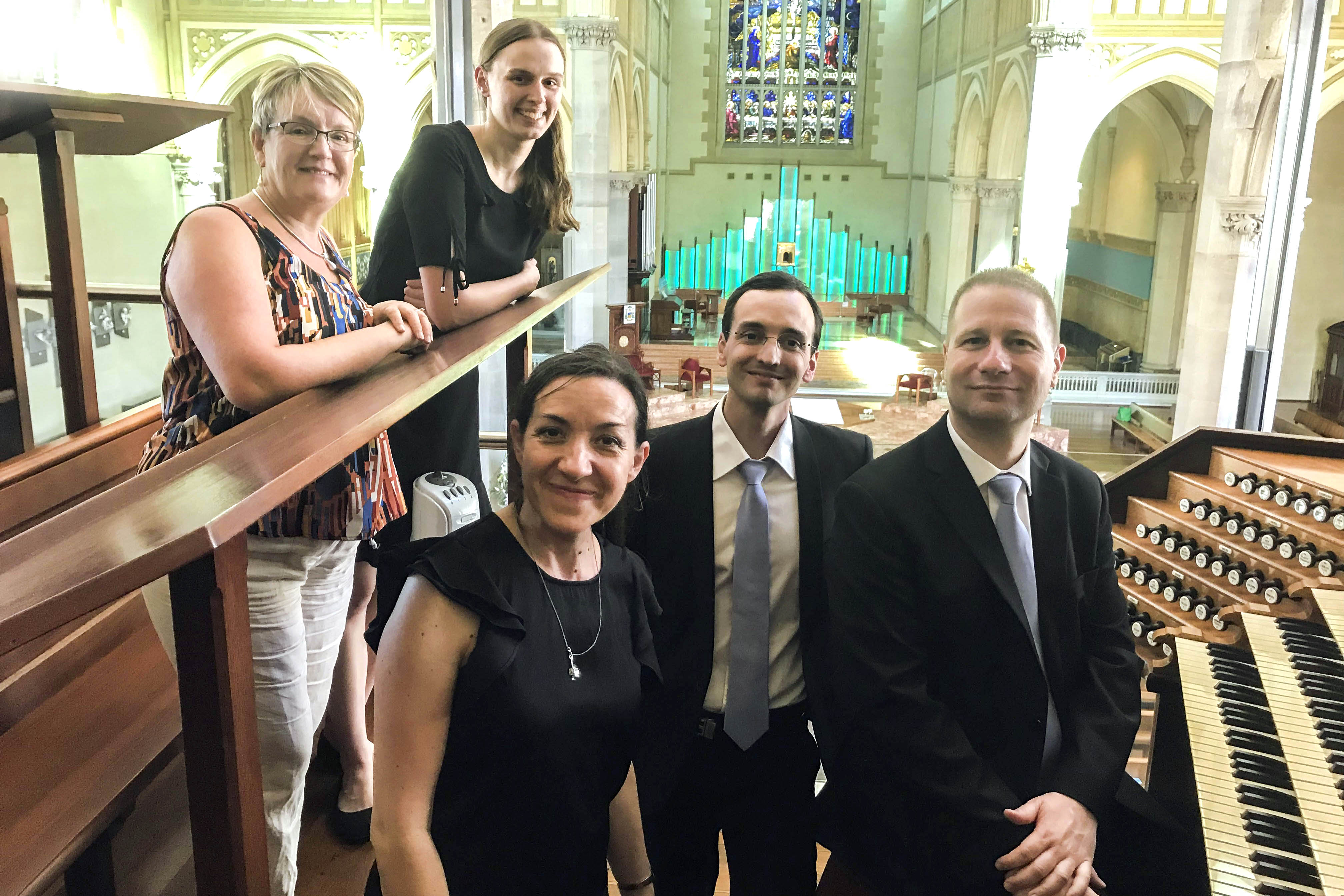 Johann Vexo and Damien Rivière, both Notre Dame musicians, stand with the St Mary's Cathedral Director Jacinta Jakovcevic (front left) and choir members during their recent visit to Perth. Photo: Jacinta Jakovcevic.