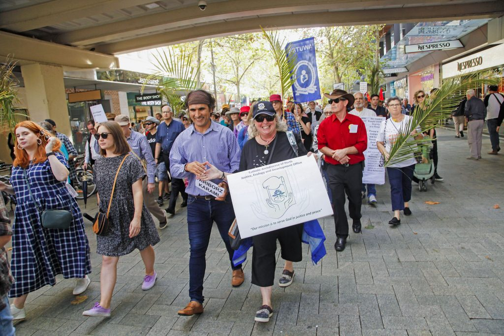 Several hundred Perth citizens marched through Perth City on Palm Sunday to demonstrate their support for refugees in Australia. Photo: Desire Mallet.