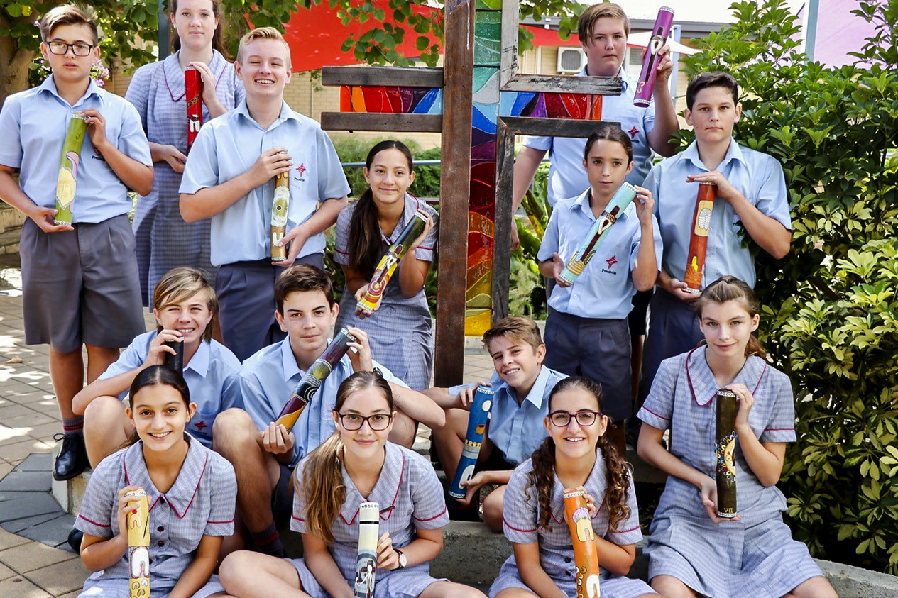 Prendiville College students proudly display the Message Sticks Photo: Prendiville Catholic College.