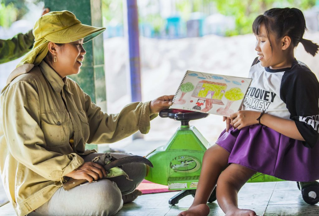 Nguyet dreams of owning her own shop one day and is preparing a blueprint of the shopfront. Photo: Nguyen Minh Dinc/Caritas Australia.