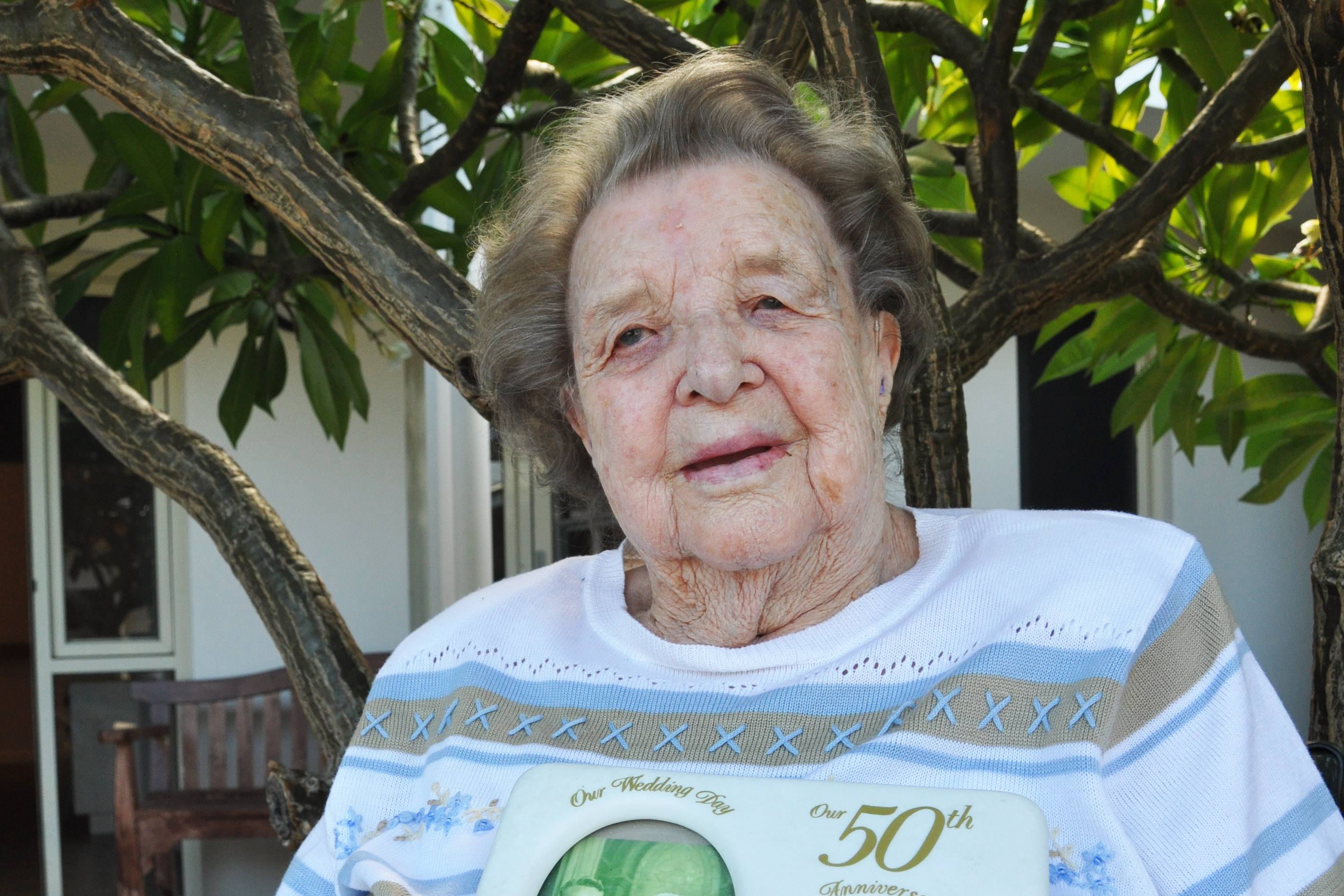 May Uphill, a 91-year-old Mercy Place Lathlain resident, reminisces her 50th wedding anniversary. Photo: Supplied.