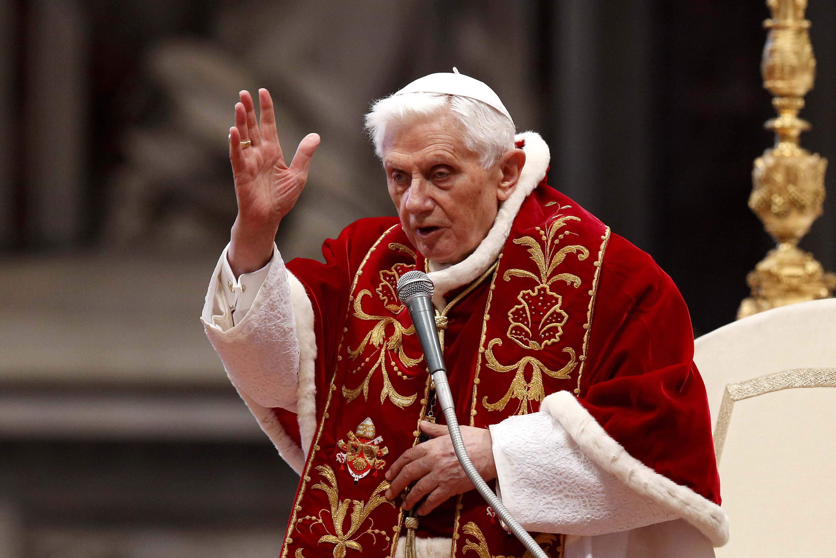 Pope Benedict XVI delivers a blessing at the conclusion of a Mass for the Knights of Malta in St Peter's Basilica at the Vatican on 9 February 2013, two days before he announced his resignation. The retired pope marked his 92nd birthday on 16 April. Photo: Paul Haring/CNS.