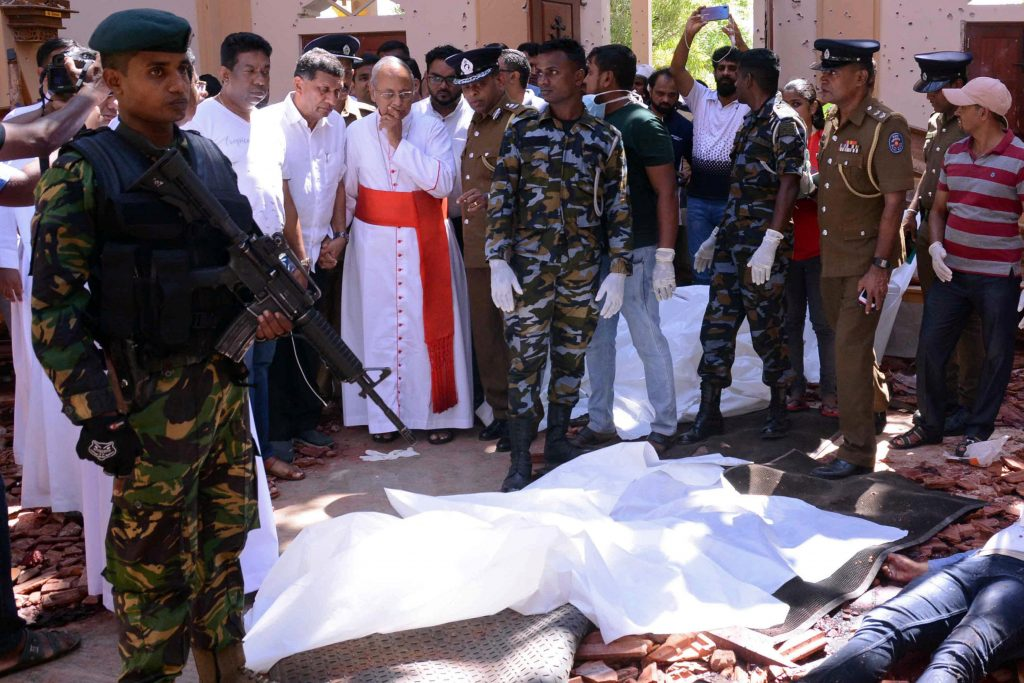 Cardinal Malcolm Ranjith of Colombo, Sri Lanka, looks at the explosion site inside a Church in Negombo on 21 April, following a string of suicide bomb attacks on churches and luxury hotels across the island. Photo: Reuters/CNS.