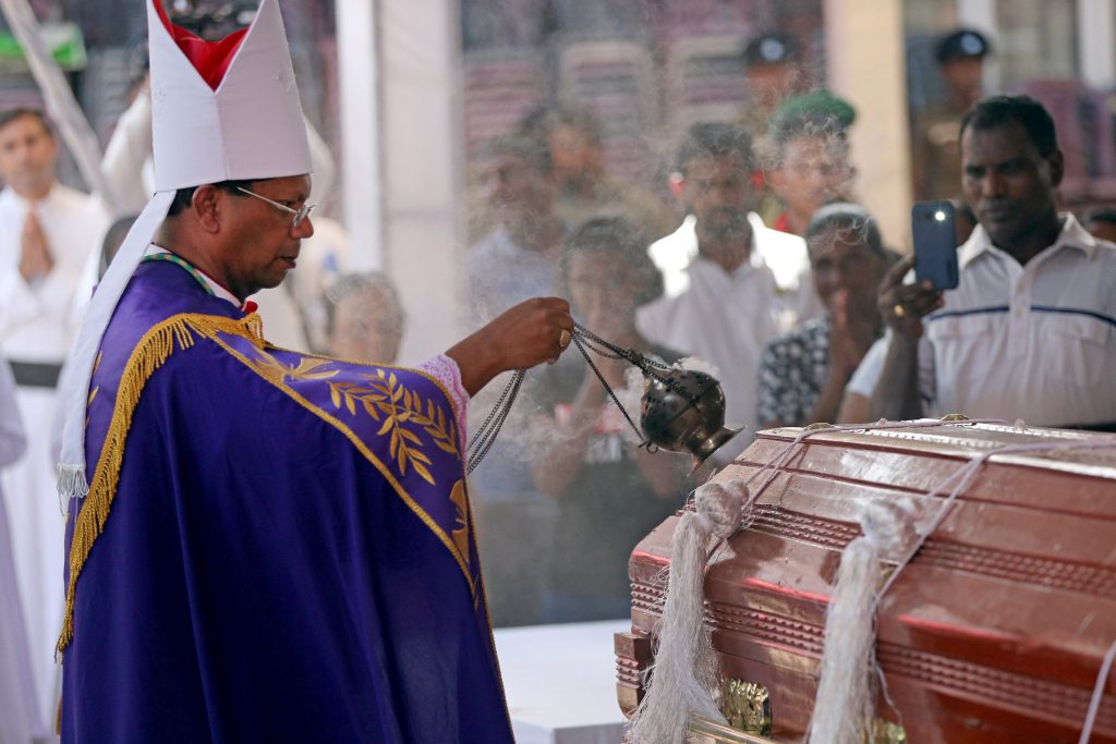 A prelate swings a censer over the casket of a victim during a funeral Mass in Negombo, Sri Lanka, on 24 April, three days after a string of suicide bomb attacks on churches and luxury hotels across the island. Photo: Athit Perawongmetha/Reuters.