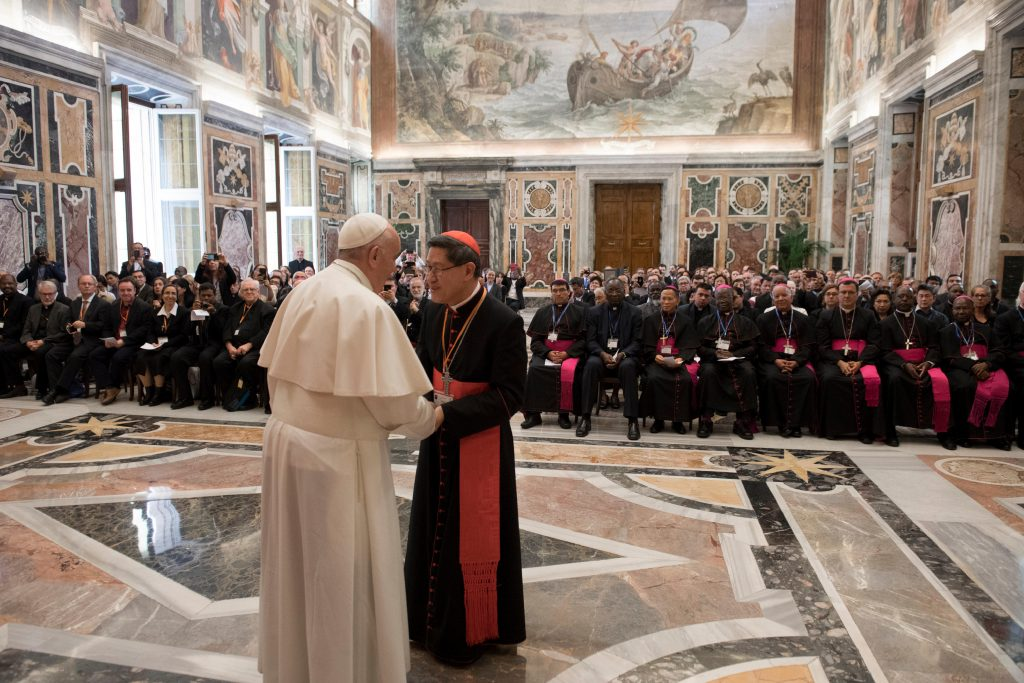 Philippine Cardinal Luis Antonio Tagle of Manila, president of the Catholic Biblical Federation, greets Pope Francis on 26 April at the Vatican during a special audience marking the federation's 50th anniversary. Photo: Vatican Media/CNS.
