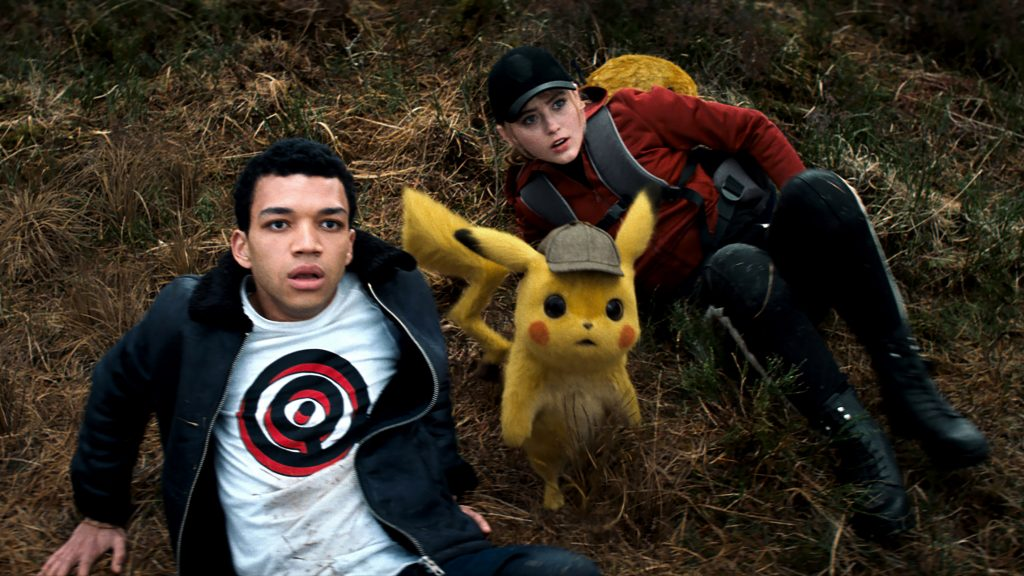 """Justice Smith, Detective Pikachu (voiced by Ryan Reynolds), and Kathryn Newton appear in the movie """"Pokemon Detective Pikachu"""". Photo: Warner Bros/CNS."""