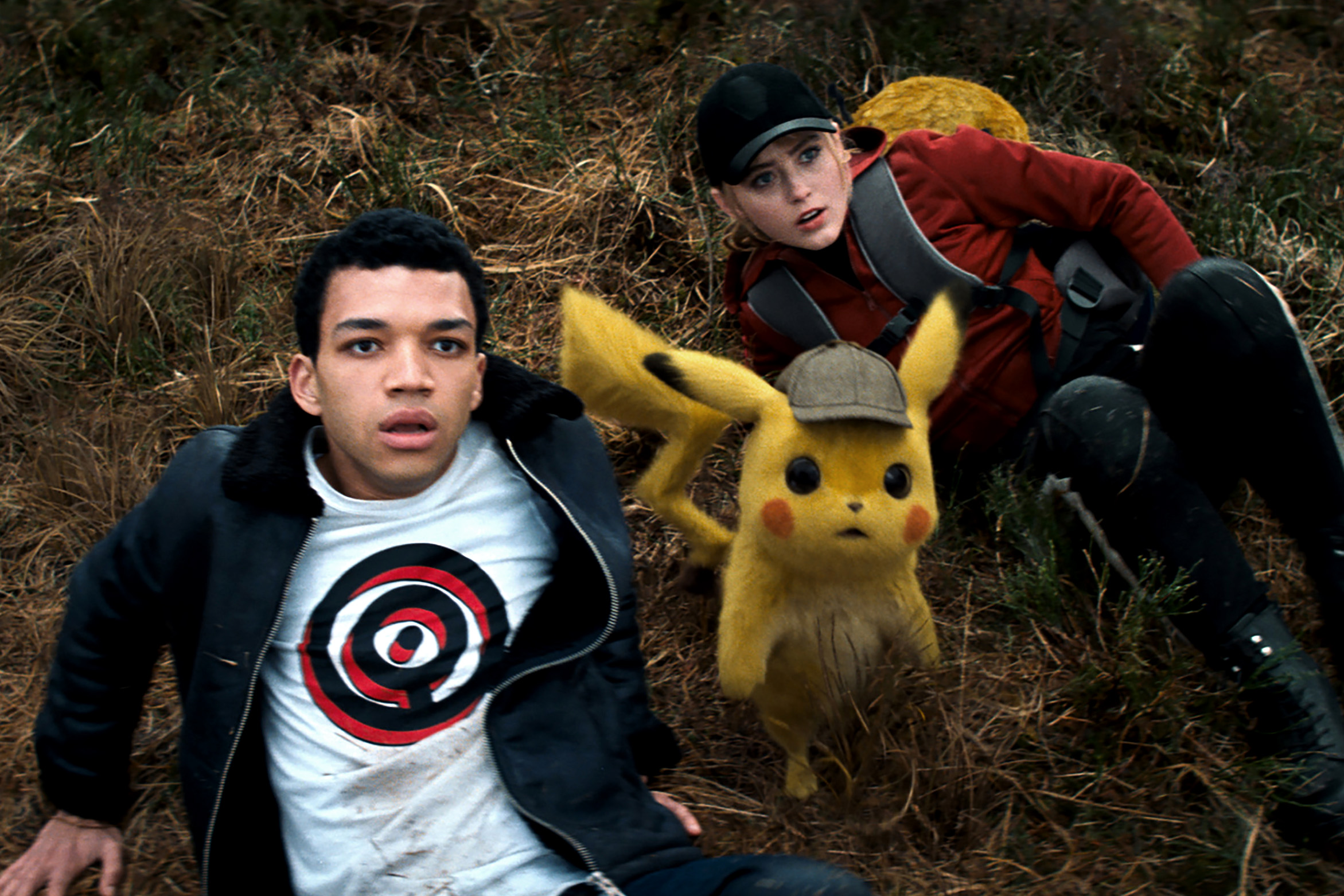 Justice Smith, Detective Pikachu (voiced by Ryan Reynolds), and Kathryn Newton appear in the movie