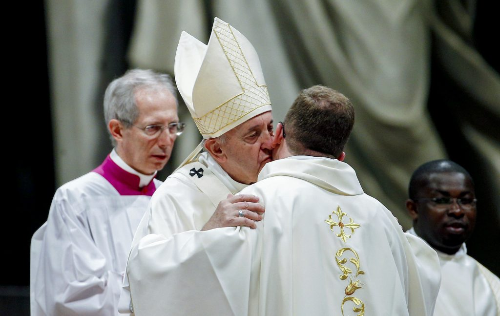 Pope Francis kisses a newly ordained priest during a Mass in St Peter's Basilica at the Vatican on 12 May 2019. The Holy Father ordained 19 new priests. Photo: Yara Nardi/Reuters.