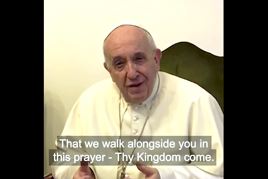 "Pope Francis speaks in a video message recorded on the phone of Archbishop Justin Welby of Canterbury, spiritual leader of the Anglican Communion, at the Vatican on 11 April. In the video, the Holy Father encourages Catholic to join the ecumenical prayer campaign, ""Thy Kingdom Come"". Photo: Thy Kingdom Come/CNS."