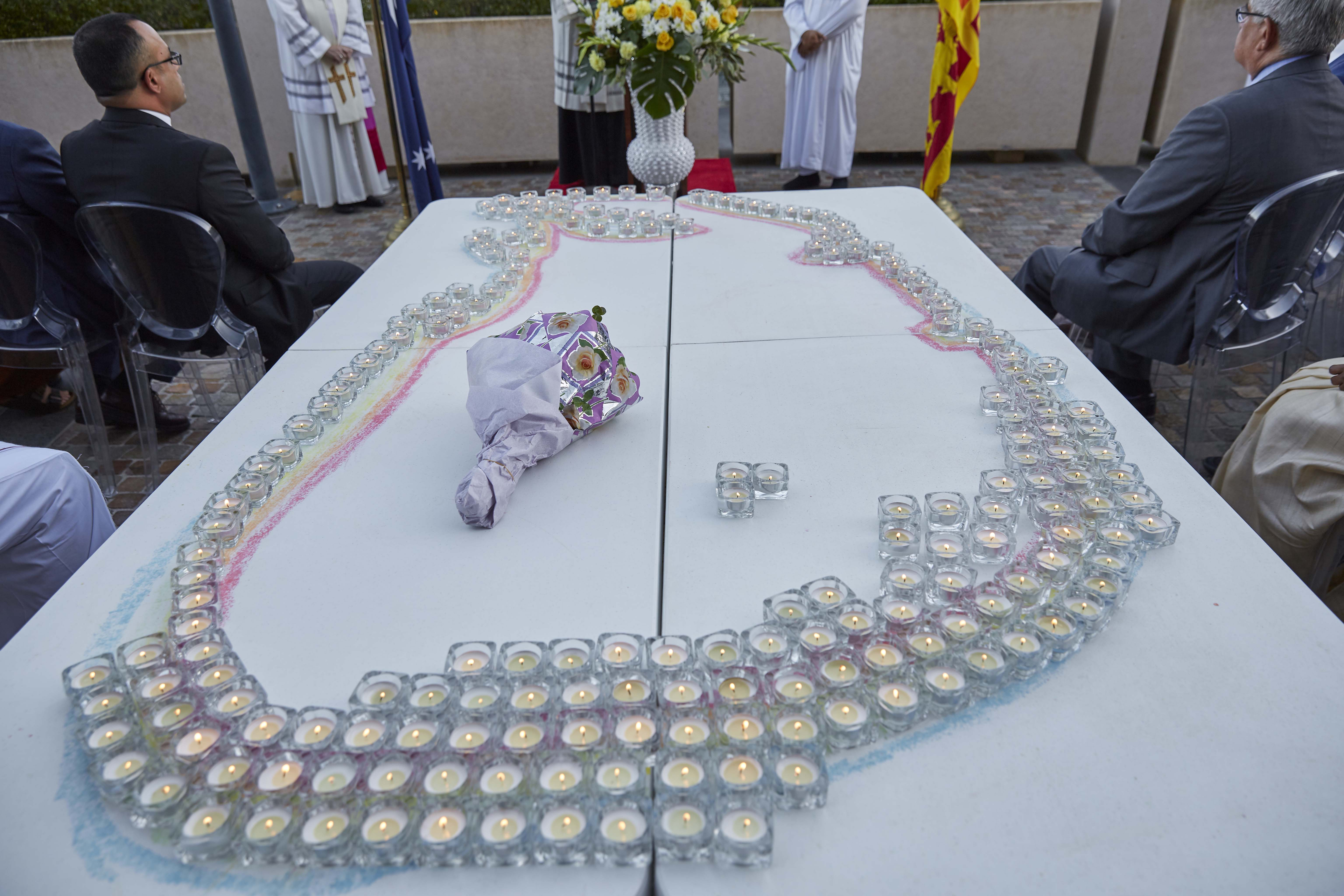 Candles were placed on a table to make the map of Sri Lanka during the interfaith service. Photo: Ron Tan.