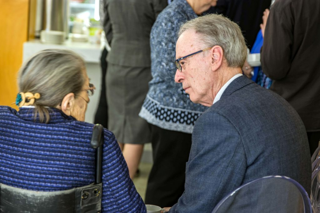 Perth Auxiliary Bishop Donald Sproxton participated in the event. He is seen interacting with a relative of Dr Kovesi during the lunch break gathering on 18 April at the St Mary's Cathedral. Photo: Amanda Murthy.