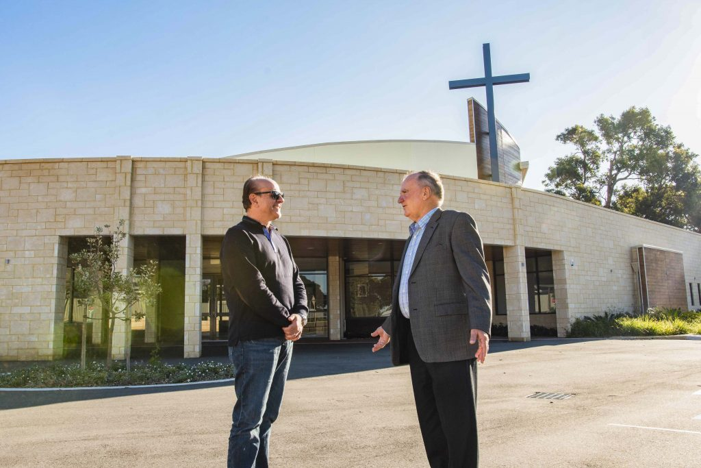 Project Manager John Abrusci (left) chats with Leadership Gifts Chairman Alex Banovich. The new St Joseph Pignatelli Church has a visible presence on Galloway St. Photo: Matthew Lau.