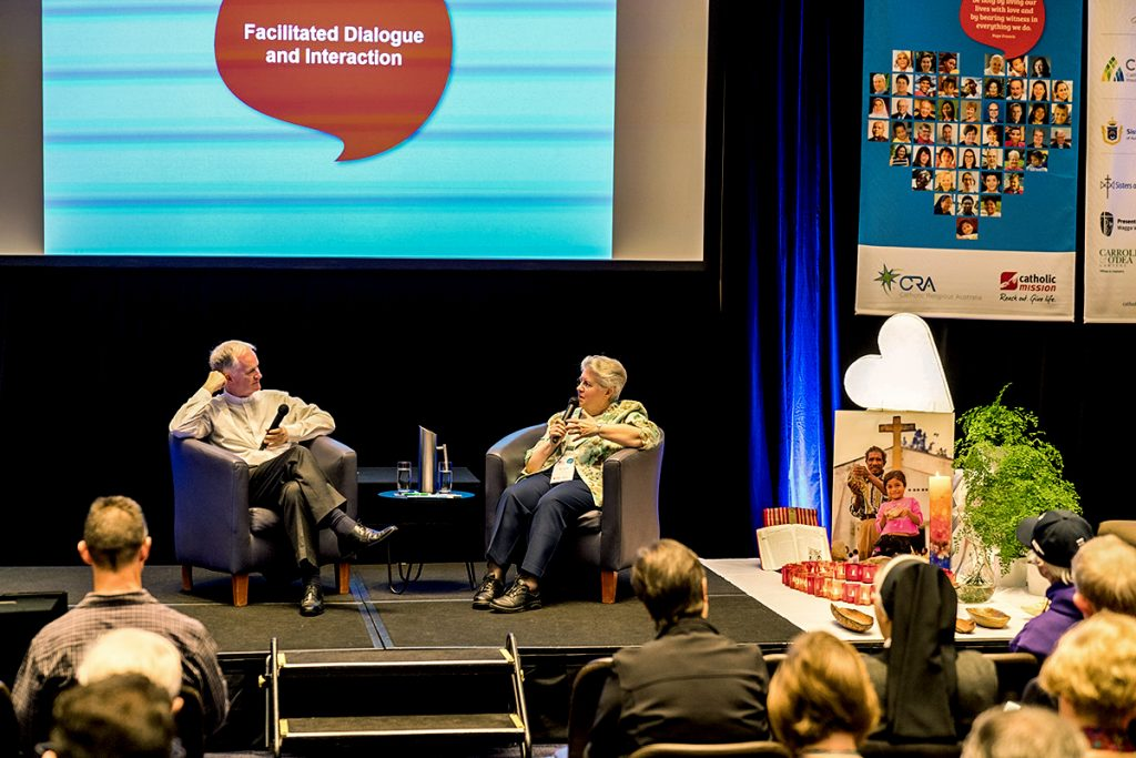 Bishop Paul Tighe and Dr Carol Zinn SSJ speak during the 2019 Catholic Mission Conference. Photo: Supplied.