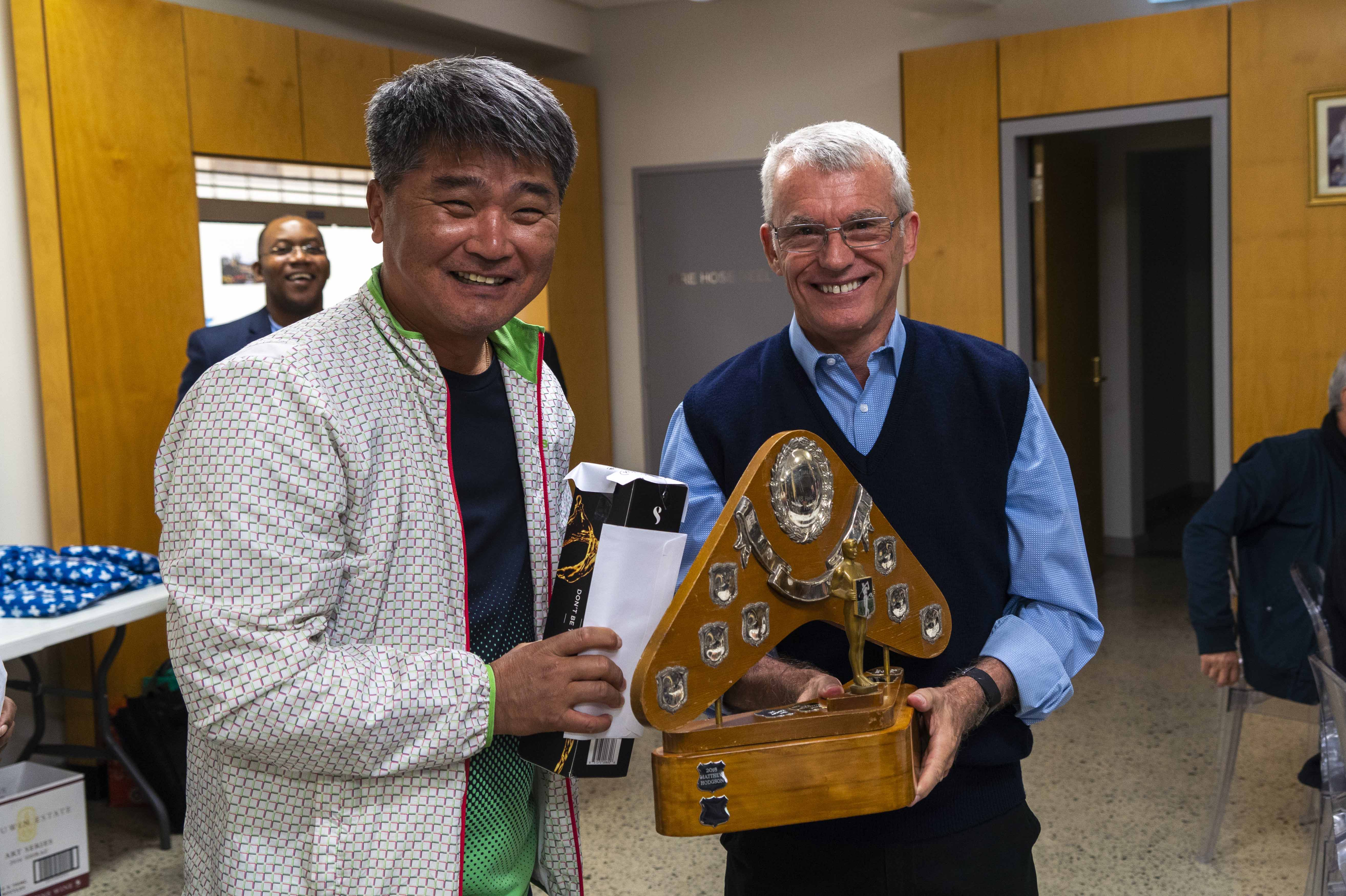 Archbishop Timothy Costelloe presents The Clergy Golf Cup to this year's tournament winner, Fr Benedict Lee. Photo: Josh Low.