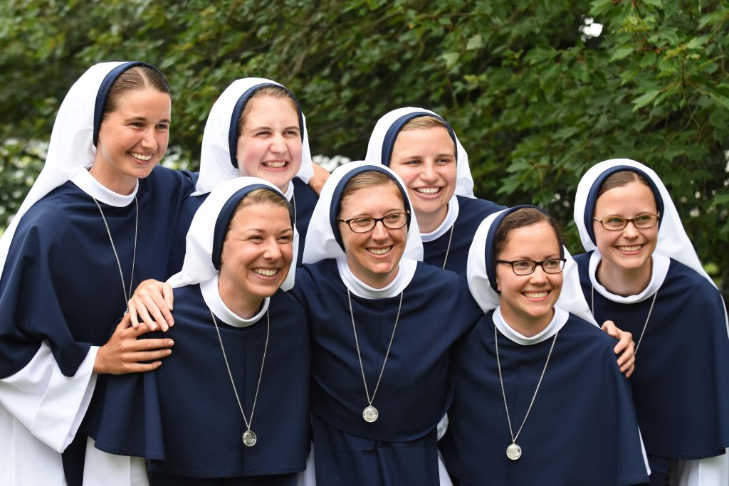 Seven young women who made their First Profession as Sisters of Life in August 2018, including Sister Mary Grace (far left) who was born and raised in Sydney. Photo: Sourced.