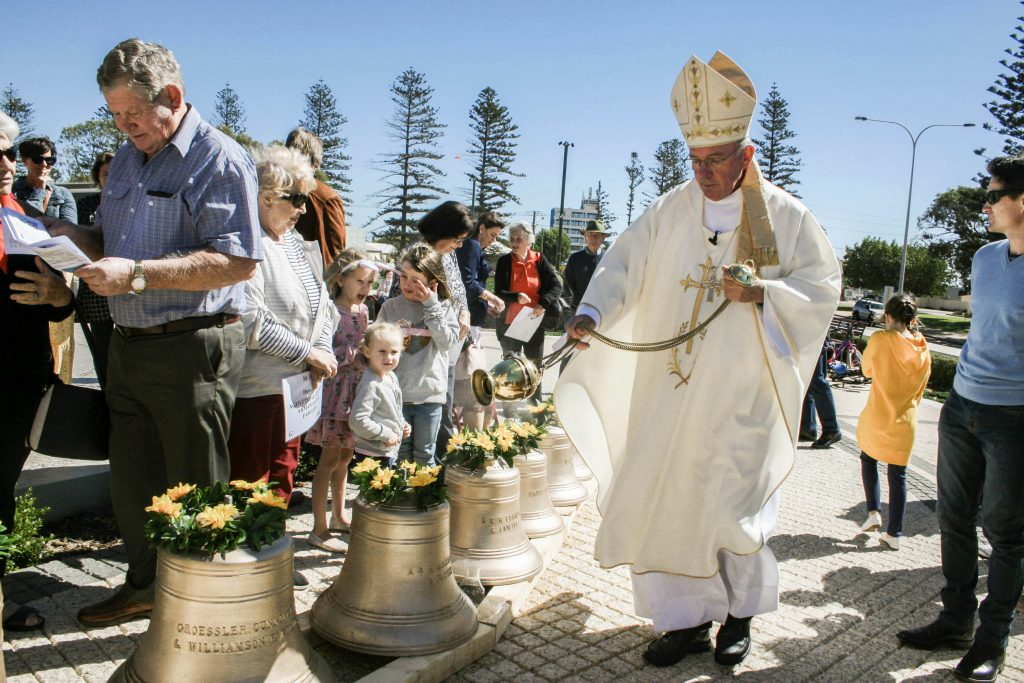 Bishop of Geraldton Michael Morrissey blesses the new carillon. Photo: Supplied.