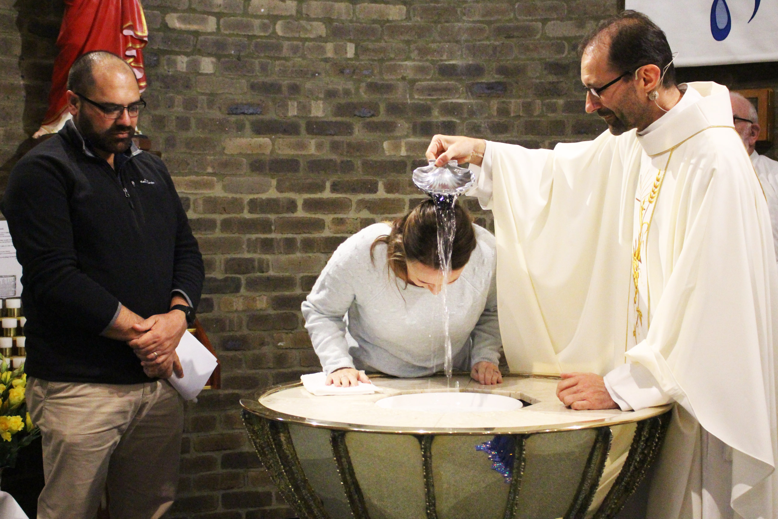 Kolbe Catholic College staff member Kelly Toma was one of the catechumens of OLOL Church to be baptised this year. Photo: Supplied.