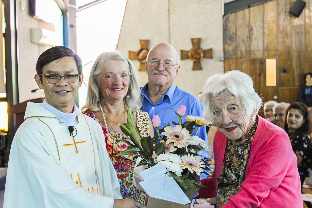 Sheelah Rudman with daughter Barbara, son-in-law Bruce Walther, and Fr Quynh during birthday celebrations after Sunday Mass. Photo: Sunil Rodrigues.