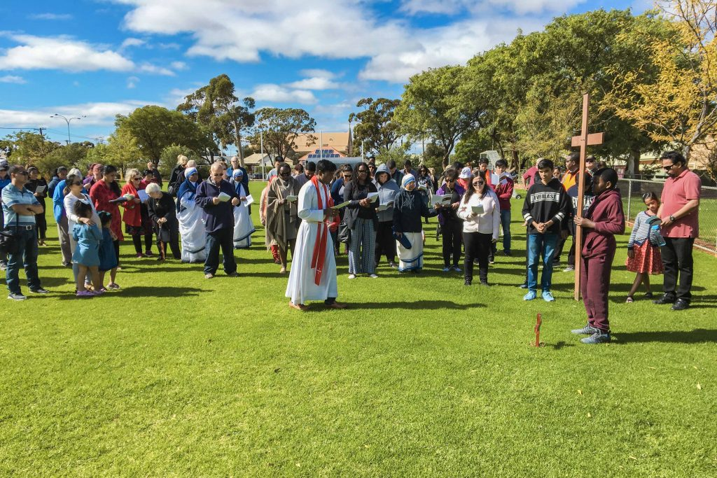 Kalgoorlie-Boulder parishioners began the Stations of the Cross at the St Mary's School oval, and then proceeded into the Church for the final station. Photo: Robert Hicks.