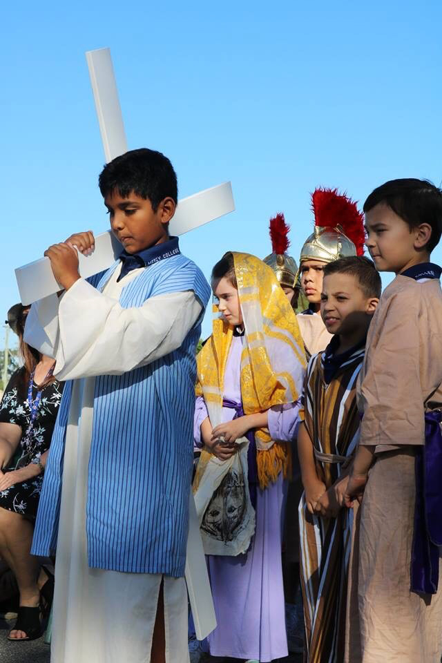 Mercy College Year 3 Chi students re-enact the Stations of the Cross on Good Friday, 19 April. Photo: Supplied.