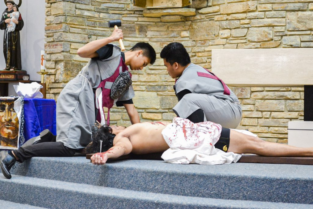 A young actor playing the role of Jesus Christ is nailed to the Cross. Photo: Supplied.