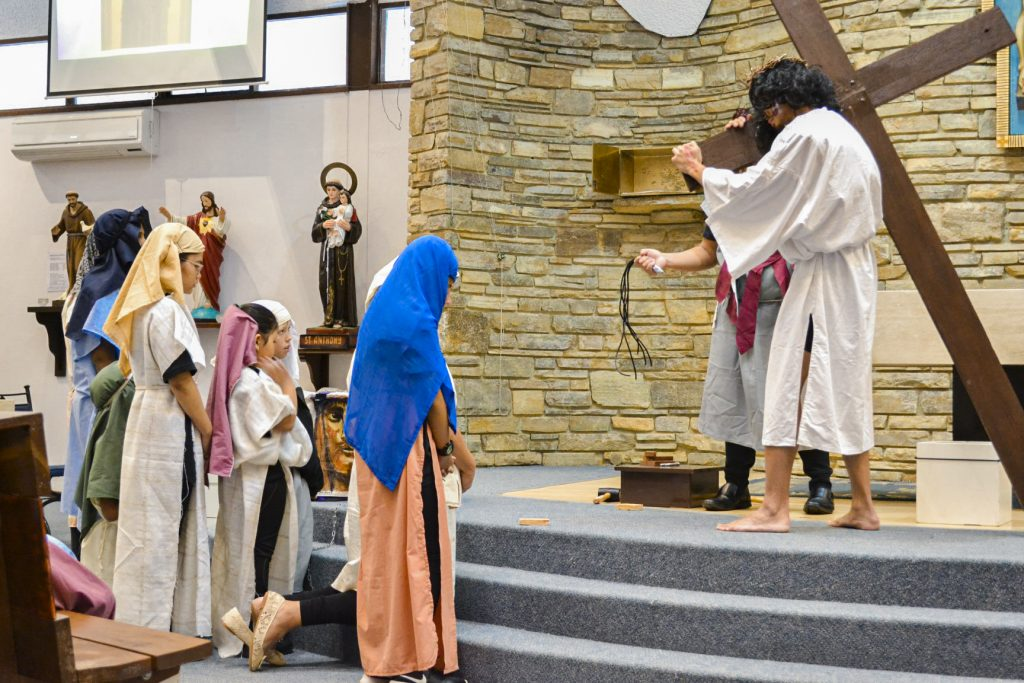 Young actresses look on with despair as Jesus carries his Cross. Photo: Supplied.