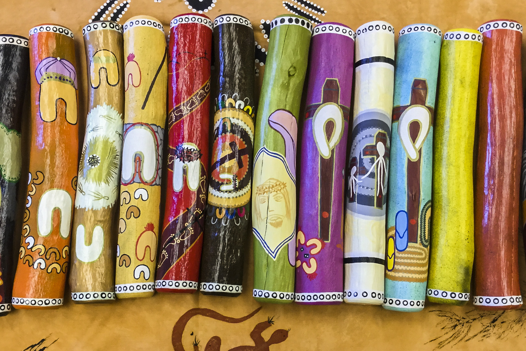 Prendiville Catholic College's Message Sticks: an example of Aboriginal and Christian art combining to tell the story of the Stations of the Cross. Photo: Supplied.