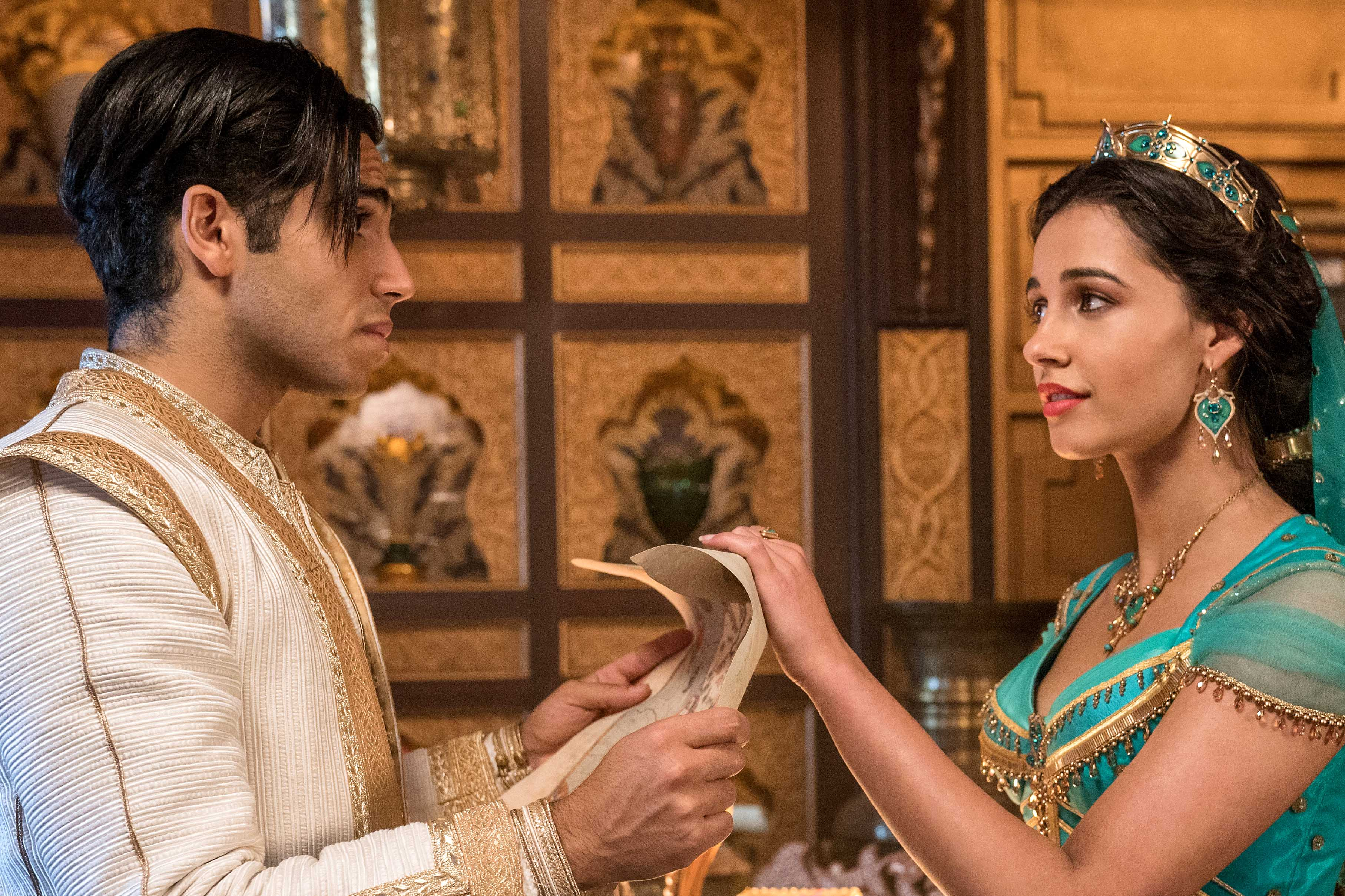 Mena Massoud and Naomi Scott star in a scene from the movie