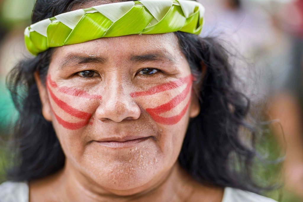 A woman participates in a march of indigenous people through the streets of Atalaia do Norte in Brazil's Amazon region on 27 March 2019. The Vatican was to release the working document for the Synod of Bishops for the Amazon on 17 June. Photo: Paul Jeffrey/CNS.